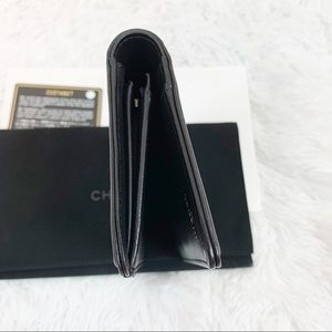 CHANEL Bags - Chanel black quilted leather boy flap long wallet